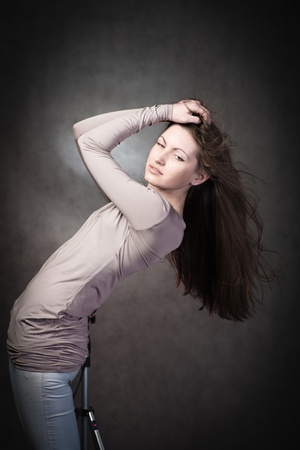portrait of a young girl in sexual youth jeans