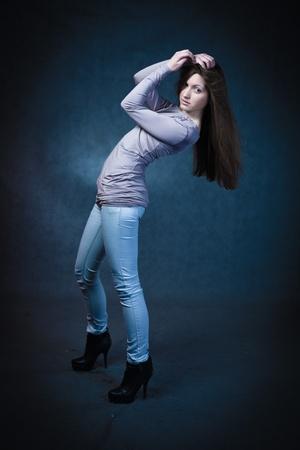 Beautiful Woman Portrait. Sexy Girl in jeans studio shot
