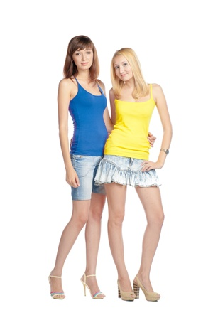 two close frends in tank top embracing on white background studio full body shot
