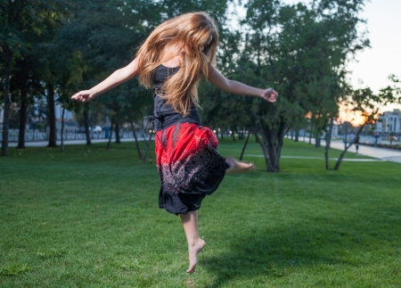 Long haired free style dancer  Girl jumping like flying bird