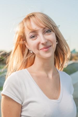 blonde 20s women head and shoulders outdoor against sky