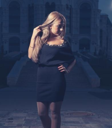 blonde at night posing, toned image