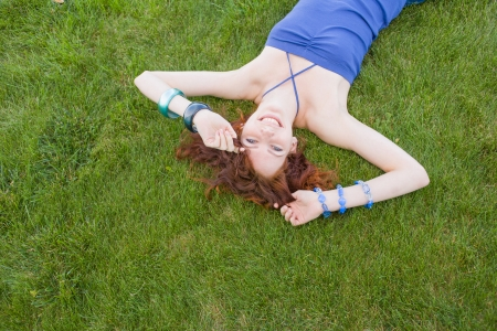 redhead lay on grass