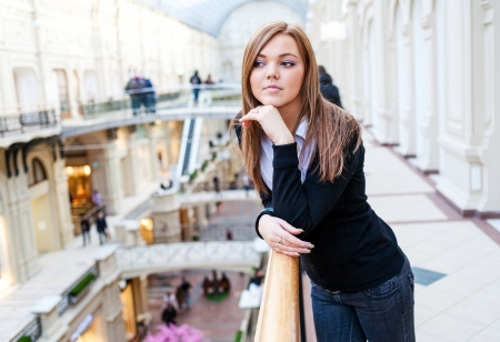 Photo of young beautiful lady inside the big mall
