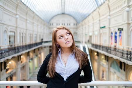 Photo of young beautiful lady inside the big mall  Central composition shot