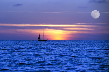 Photo pour A sailboat moves across the ocean on its journey - image libre de droit