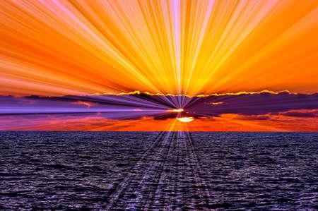 Foto für A Colorful Brilliant Set of Sun Rays Emanates from Behind then Clouds - Lizenzfreies Bild