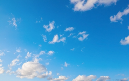 White soft clouds on blue sky