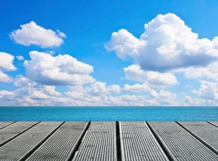 Wood walkway on sunny day near sea