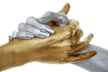 closeup of gold and silver hands