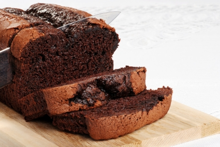 cutting slice belgium chocolate cake focus on knife tip