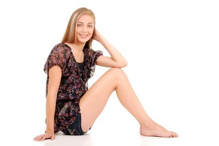 Foto de Blonde teen girl sitting - Imagen libre de derechos