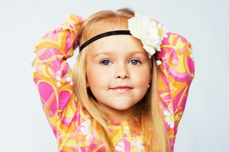 Beautiful little girl in colorful clothing