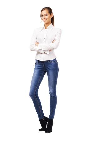 Foto de Lovely woman in white shirt and blue jean, isolated on white  - Imagen libre de derechos