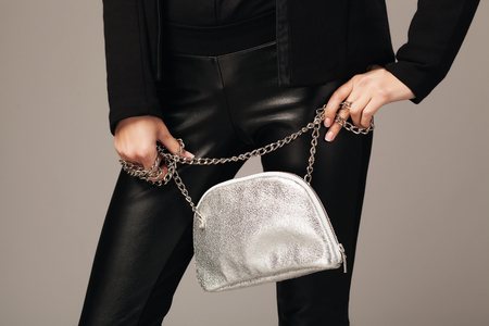 Photo for Elegant woman with a silver fashion bag - Royalty Free Image