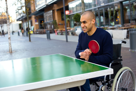 young man in a wheelchair playing table tennis