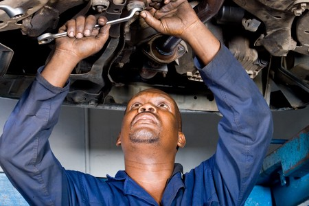 african mechanic working on a vehicle