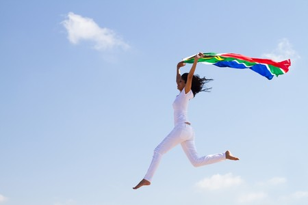 woman soaring in sky with south african flag