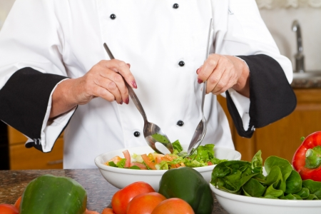 professional female chef prepare a salad