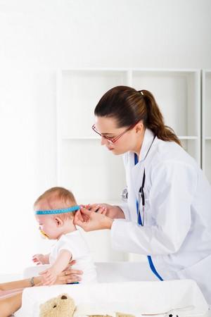 nurse measuring baby's head