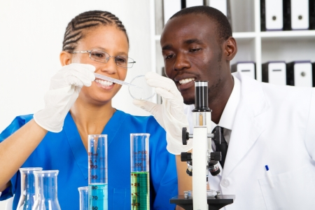 two scientists doing work in lab