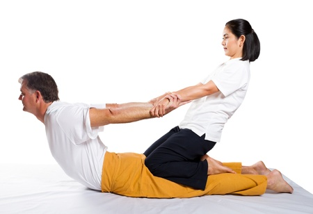 middle aged man receiving thai massage