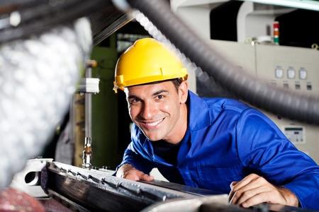 happy modern blue collar worker in factory
