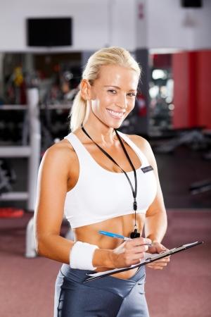 happy female gym instructor portrait