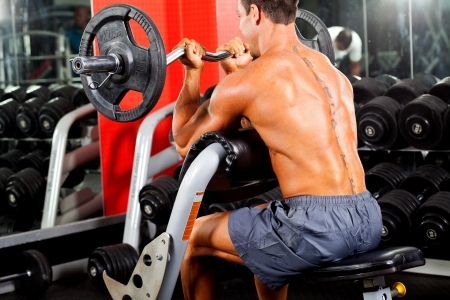 man working out with barbell in gym