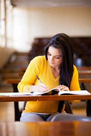 female college student studying in lecture hall