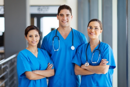 group of young hospital workers in scrubs