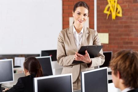 pretty female high school teacher portrait in computer room