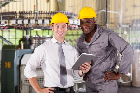 modern factory manager and worker with tablet computer