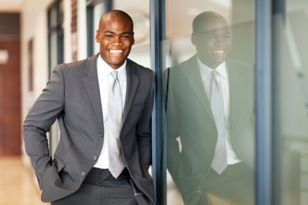 happy african american business executive portrait in office
