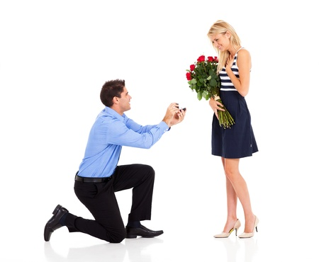 Photo for young man down on his knee proposing to girlfriend - Royalty Free Image