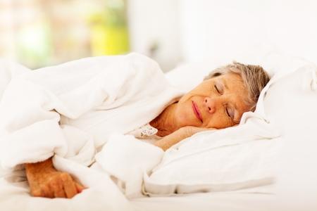 senior woman sleeping on bed