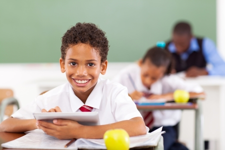 primary school boy using tablet compute in classroom