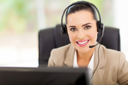 Portrait of friendly call center consultant with headphones