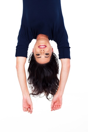pretty young woman upside down portrait on white