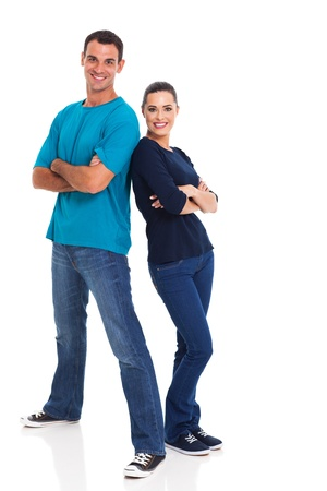 Photo pour portrait of cheerful young couple leaning on each other over white background - image libre de droit