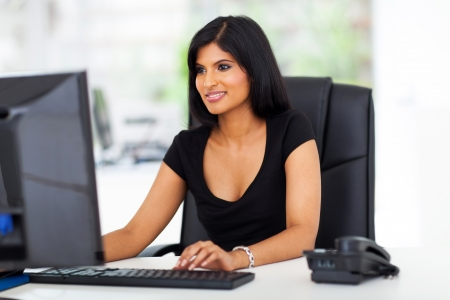 beautiful young hispanic businesswoman working in office