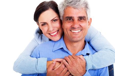 loving middle aged couple on white background