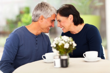 loving mature couple spend time together at homeの写真素材