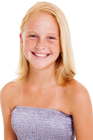 happy teen girl with freckles isolated on white