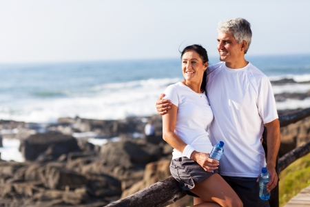 Photo for happy mature couple relaxing after exercise at the beach - Royalty Free Image