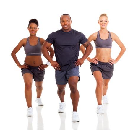 Foto de three healthy people exercising on white background - Imagen libre de derechos