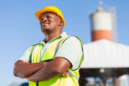 Photo for happy african male constructor with arms folded - Royalty Free Image