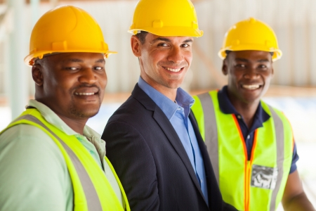 group of cheerful professional construction manager and workers
