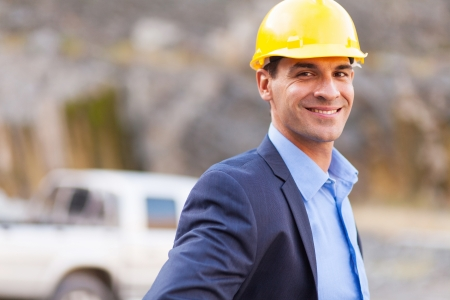 smiling mine manager at mining site