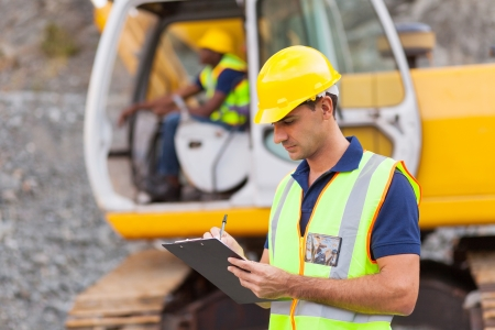 Photo for construction manager writing report at construction site - Royalty Free Image
